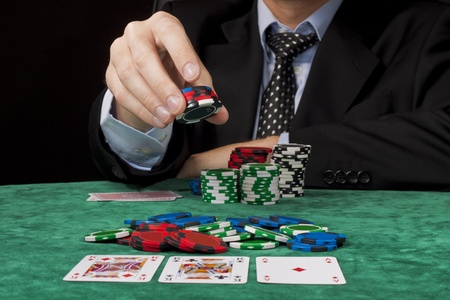 em: A businessman placing a bet in a Texas hold