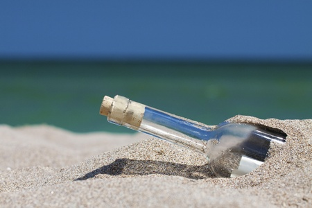 Message in a bottle with sea and the horizon. Horizontal shot with shallow depth of field.