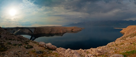 Panoramic HDR photo of the bridge to the Pag island in Croatia. Velebit mountain in the background. photo