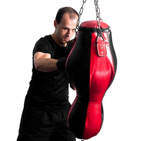 Boxer punching a sand bag photo