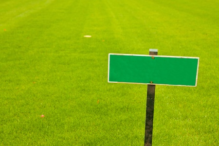 Green grass with a sign, horizontal shot with copy space photo