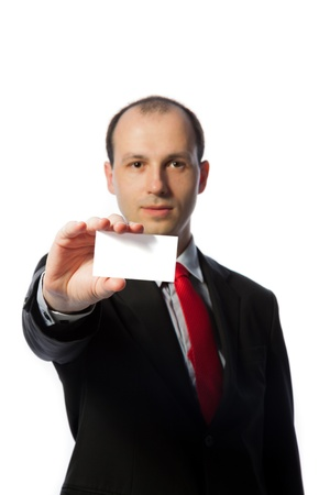 Businessman holding a blank business card, vertical, isolated on white photo