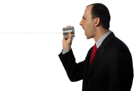 Businessman yelling through an oldschool can phone, horizontal, close up, isolated on white photo