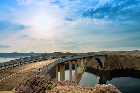 Bridge to the Pag island with sun and clouds, Croatia photo
