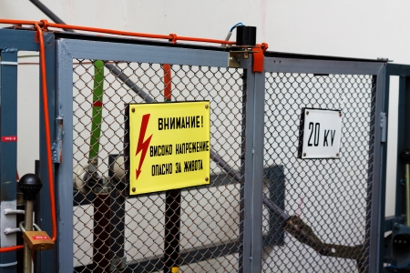 High voltage warning signs on a fence before the equipement Stock Photo - 18240192