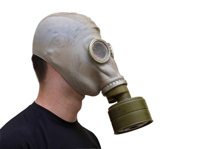Man with old style gas mask isolated on white background, side view photo