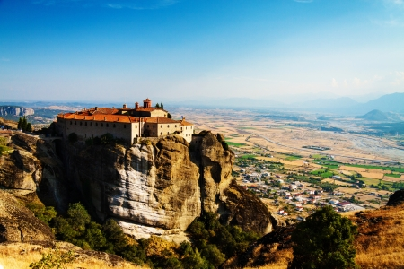 Meteora Monasteries, Greece, horizontal shot with blue sky and view of the valley photo