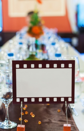 Movie film sign for an official dinner table photo
