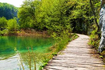 Wooden path near a forest lake in Plitvice Lakes National Park, Croatia Stock Photo
