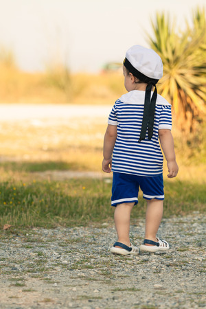 Toddler dressed as a sailor walking and exploring