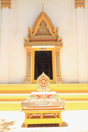 dhamma: Wheel of Dhamma and temple at Wat Tanot