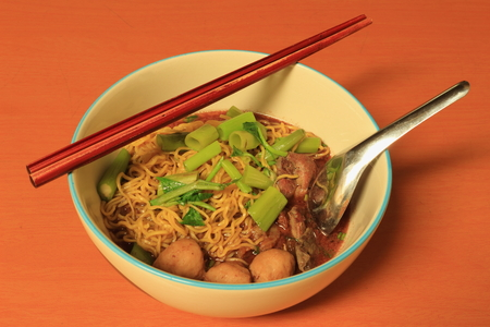 Egg Noodle with Thicken Soup on the brown table