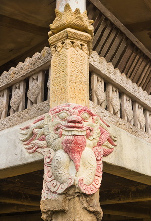 daemon: the old stone carving daemon head at the Ancient temple pole Stock Photo