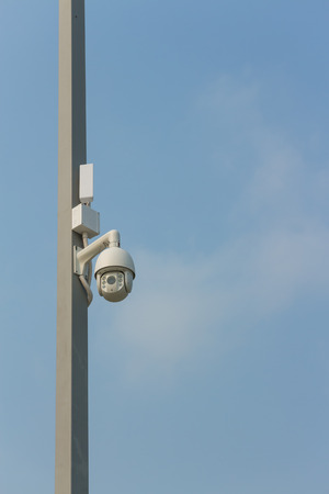 private viewing: CCTV on the pole with sky background Stock Photo