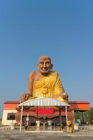 pu: Monk statue for Luang Pu Thuat sitting under sunlight