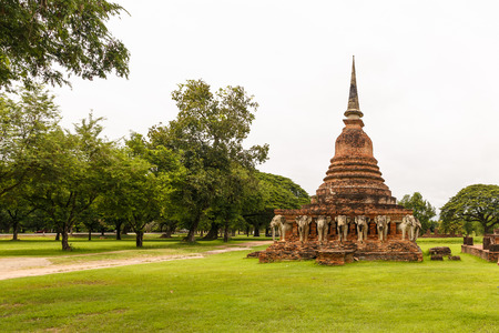 Stupa with elephants at Sukhothai Historical Park in Thailand