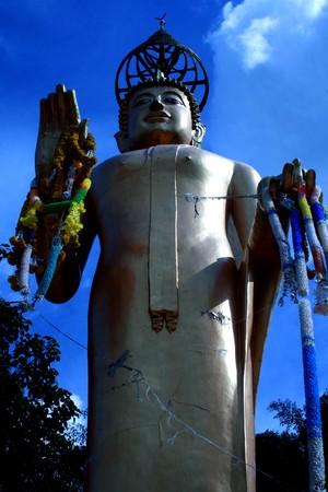 veneration: Standing Buddha. Stock Photo