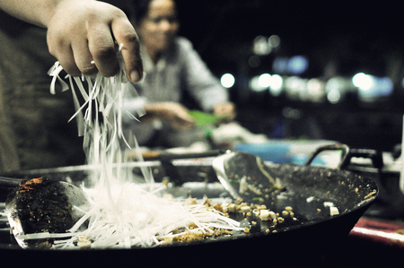 The chef is doing Pad Thai Pad Thai is a Thai food. Stock Photo