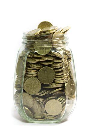 Glass jar full of euro coins, twenty cents, on white background