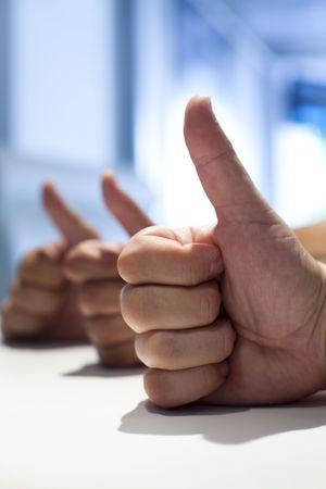 winning idea: three man having their thumbs up