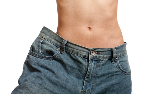 Young woman wearing her old jeans, showing her body after losing weight  Stock Photo - 9357200