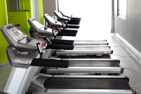 High technology motorized Treadmills in a row (using shallow depth of field) photo