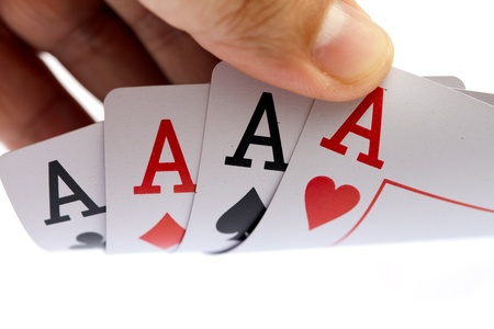 I win. Holding four aces, close up, on white background photo
