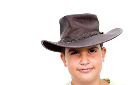Young cowboy smiling, looking at camera, on white background photo