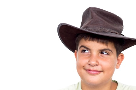 Young cowboy smiling, looking up, on white background Stock Photo - 9768725