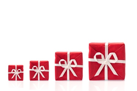 earn more: Ask  for more, four red gift boxes in a row, in different sizes,  isolated on white bakcground with space for text (detailed large file) Stock Photo