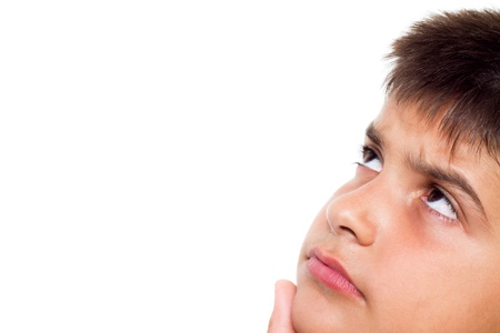 Close up, cropped  portrait of a young boy looking with doubt (isolated on pure white background) Stock Photo - 9768731