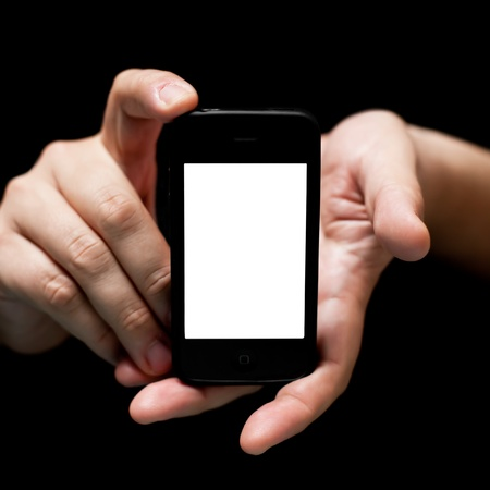Hands holding - showing smartphone, empty,  front view, on black background, artistic style,  using very shallow depth of field   Stock Photo