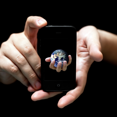 The world in your hands... smartphone (on black, very shallow depth of field)