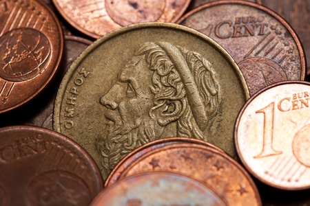 Old greek coin among euro coins, drachmas (with the face of Hommer, the ancient Greek  poet) photo