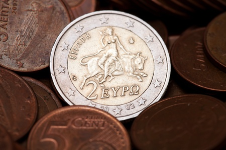 Greek two euros coin among  coins of five cents, representing the abduction of Europe (from Greek Mythology) photo