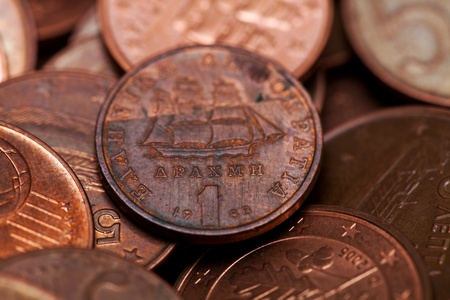 One drachmas, old Greek coin among euro coins (macro shot, shallow DOF) photo
