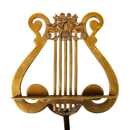 白い背景上に分離されて青銅製で、アンティークの譜面台 写真素材