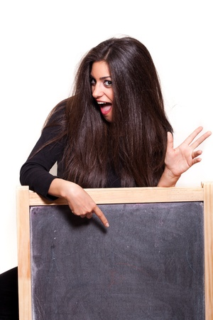 cant: An Offer You Cant Refuse. Very excited woman pointing Your idea at a blank blackboard. Ready for your text.  Stock Photo