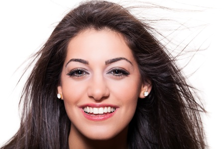 Portrait of a smiling girl , close up on white background