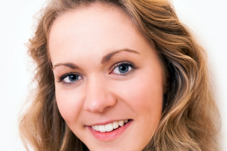 Close up portrait of a blond,  blue eyed, confident, young woman with a beautifull smile Stock Photo - 15478006
