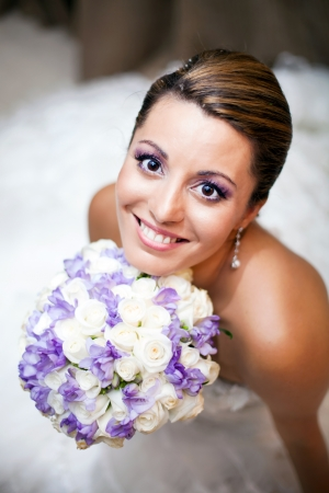 Happy bride holding flowers photo