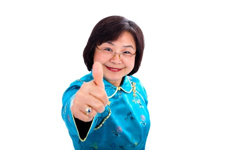 Confident Smiling Asian Woman Thumbs Up, Wearing Traditional Chinese Suit, Close Up On White Background photo