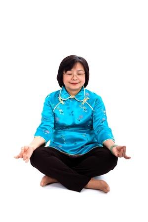 meditates: Chinese Woman Meditates, on white background