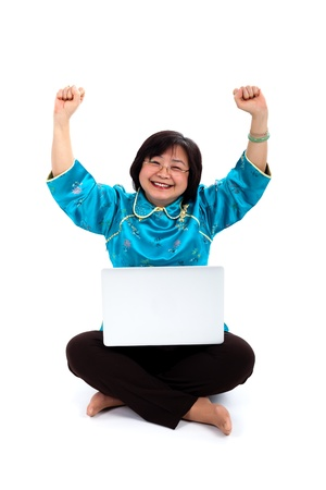 Happiest Chinese Woman with laptop, on white background photo