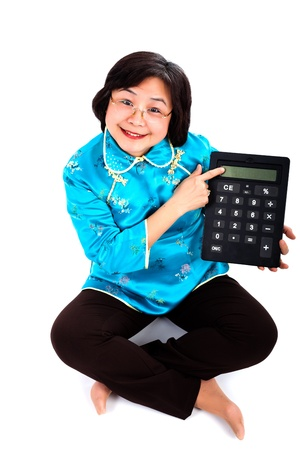 calculator chinese: Chinese Woman smiling, showing a very big calculator,  on white background Stock Photo