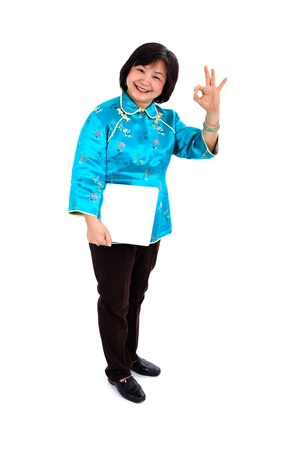 Chinese Woman Holding Laptop, making the perfect sign, on white background photo