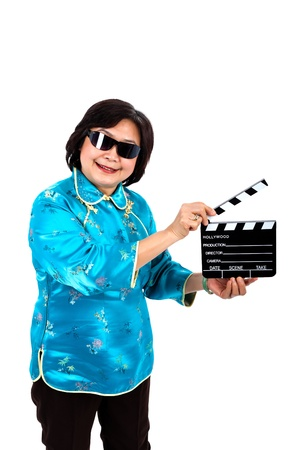 film shooting: Chinese Woman ready for film shooting, standing, wearing black glasses,  on white background Stock Photo