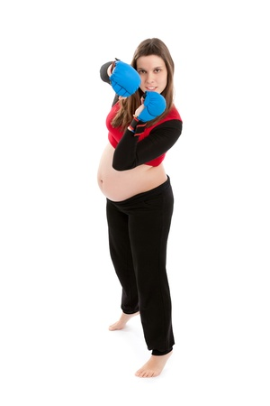 instincts: Maternal Instincts, Protection  Pregnant young woman wearing boxing gloves, ready to protect her child  Studio shot isolated on white