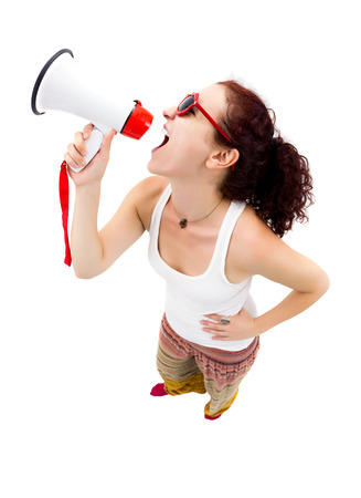 Woman holding megaphone and yelling, fisheye lens, studio shot Stock Photo - 22533734
