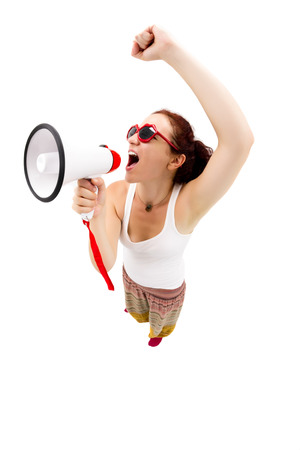 Woman holding megaphone and yelling, fisheye lens, studio shot photo